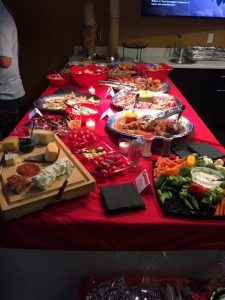 A spread of food on a table with a red tablecloth at our Ingredients for Success event in August 2019.