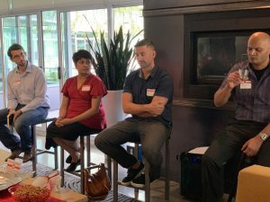 A panel of four speakers are seated, listening during our Ingredients for Success event in August 2019.